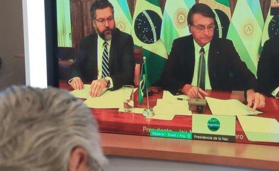[Por vídeo, Bolsonaro tem primeira reunião bilateral com presidente da Argentina ]