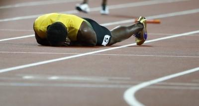 Bolt sofre lesão e abandona prova de despedida da carreira