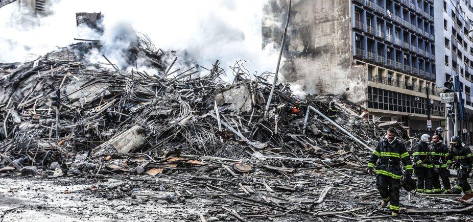[Bombeiros seguem nas buscas por 5 desaparecidos em escombros de prédio ]