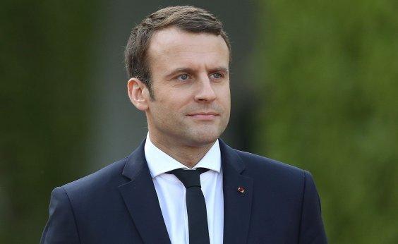 [Macron defende sanções a nação da UE que negar asilo]