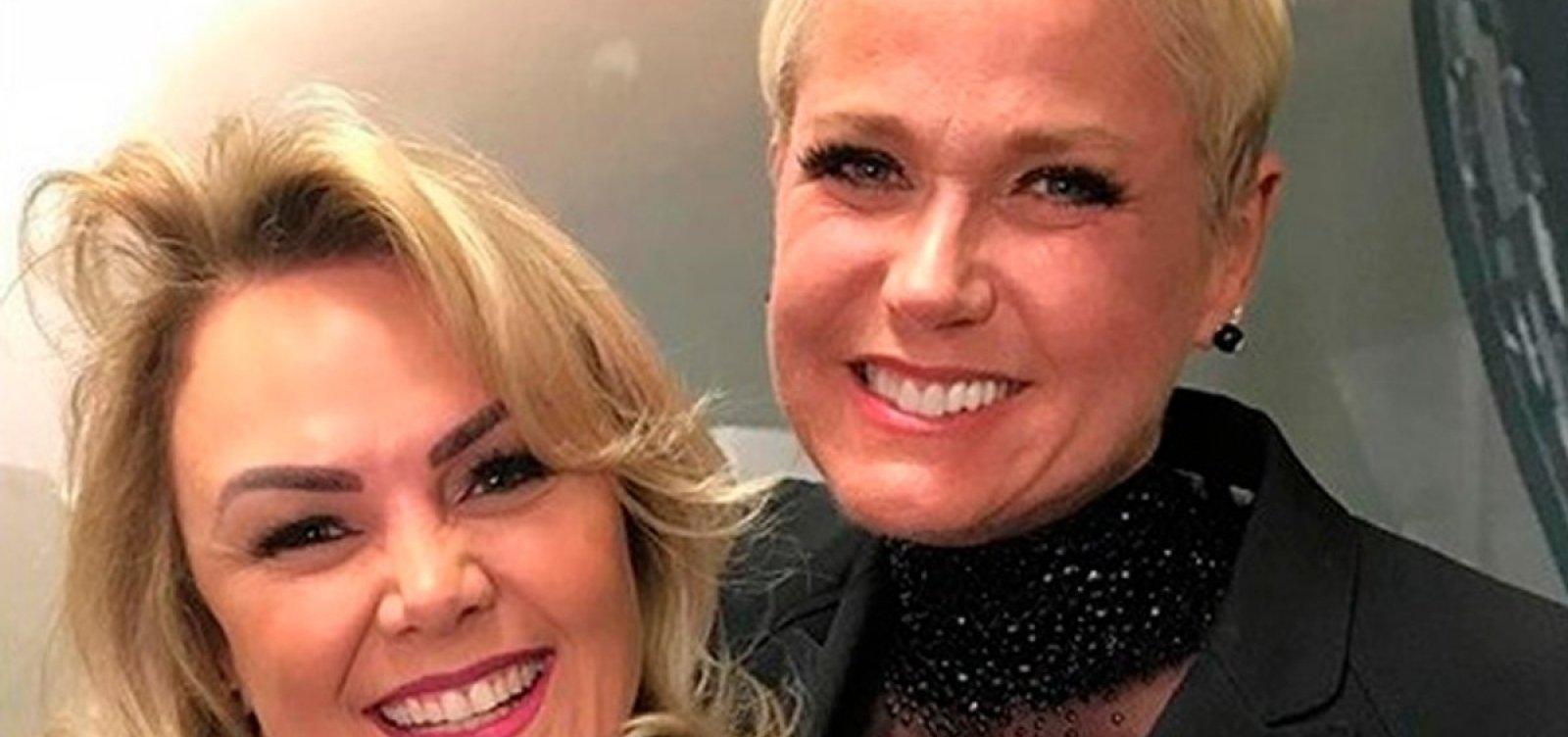 [Xuxa contrata segurança para ex-paquita agredida por marido]