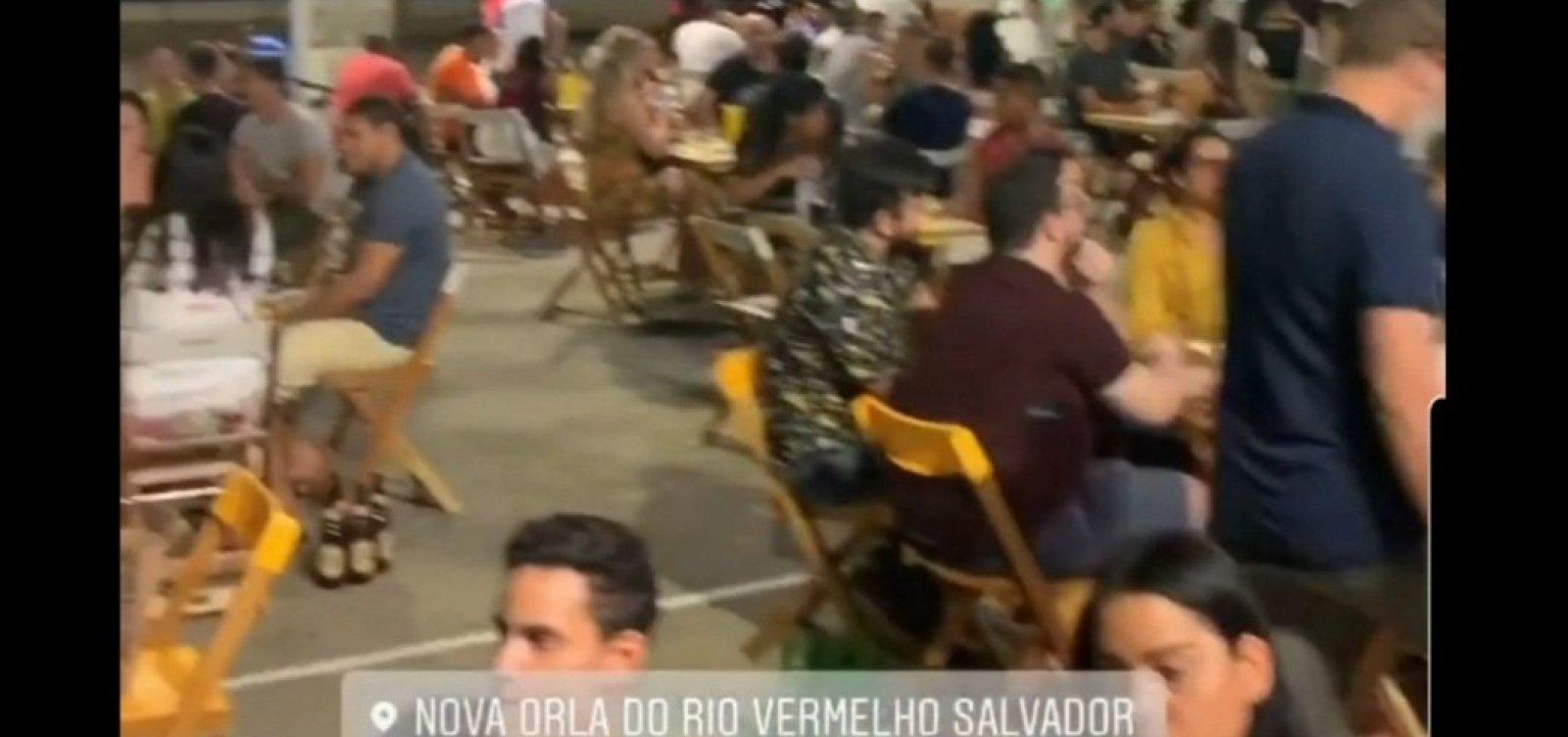 [Em 1ª sexta com bares e restaurantes abertos, Largo da Dinha tem mesas cheias e pessoas sem máscara]